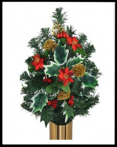 Evergreen and poinsetta crypt flowers