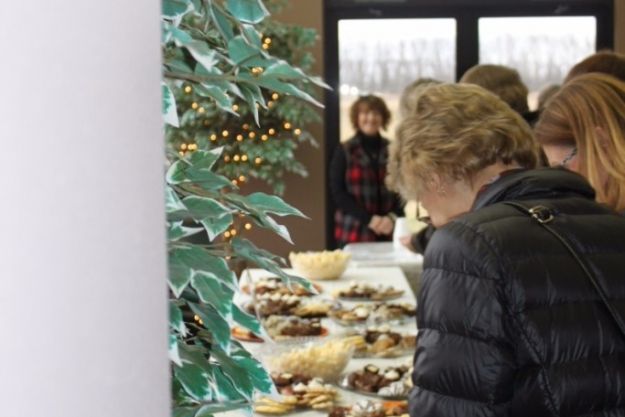 Holiday Memorial service guests going through the holiday refreshments line